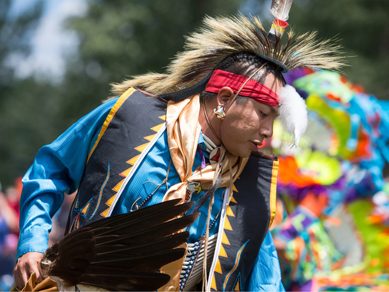 A traditional dancer performs in a powwow