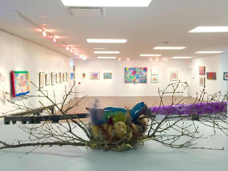 A bird nest sculpture in an art gallery
