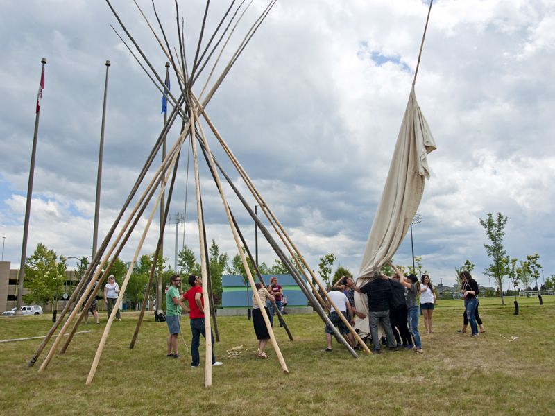 Participants of the inaugural Artsdance work together to raise a tipi | Photo: Amy Jo Espetveidt