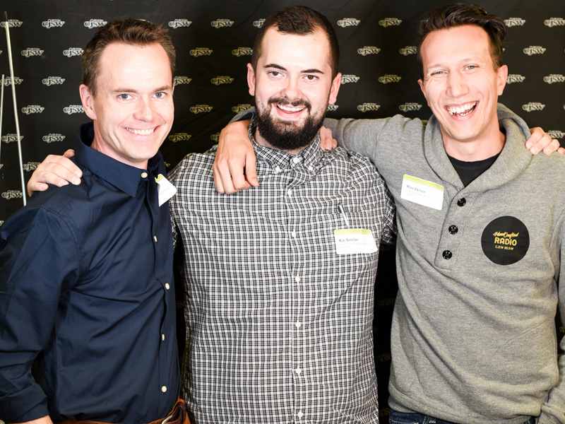 Three generations of station managers, (left to right) Chad Saunders, Kai Sinclair, and Myke Atkinson celebrate the launch of We Make Radio: 30-Something Years of CJSW | Photo: Michael Grondin, courtesy of CJSW