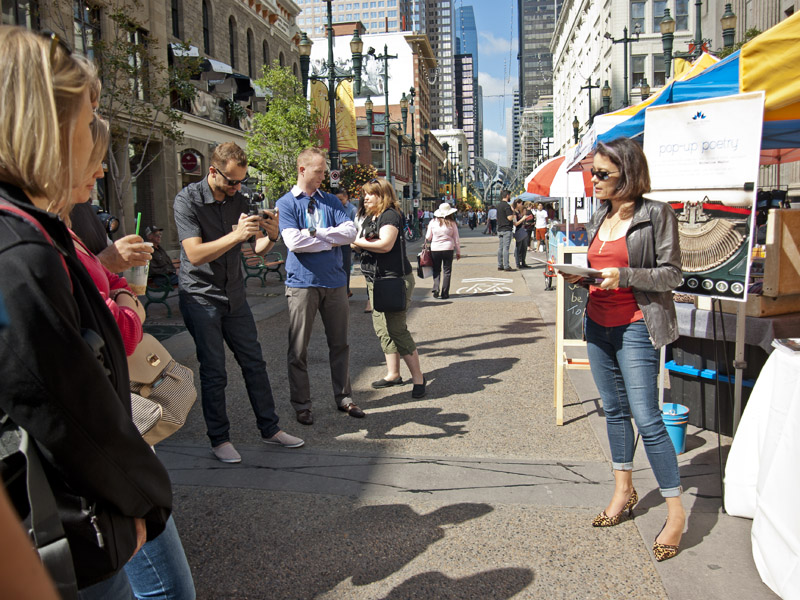 Calgary Poet Laureate and Mount Royal University instructor Micheline Maylor recites a poem on Stephen Ave. during Pop-Up Poetry | Photo: Amy Jo Espetveidt