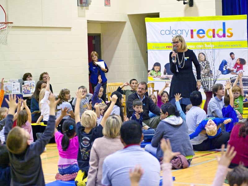 Calgary Reads founder Steacy Collyer gets young readers excited during a Reading Rally | Photo: Amy Jo Espetveidt