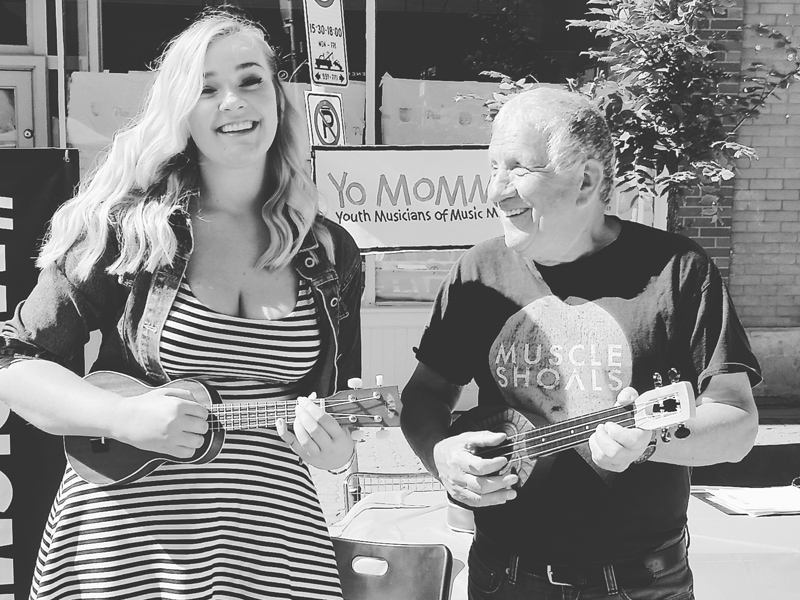 Kate Stevens and Bob Chartier promote Yo Momma with free uke lessons at the Inglewood Sunfestival | Photo: Courtesy of Kate Stevens