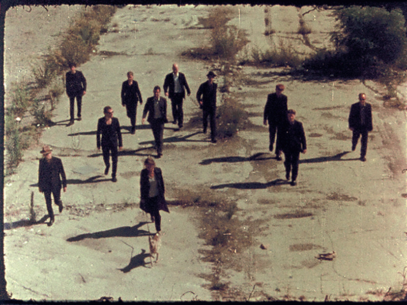 A grainy picture of group of people dressed in black