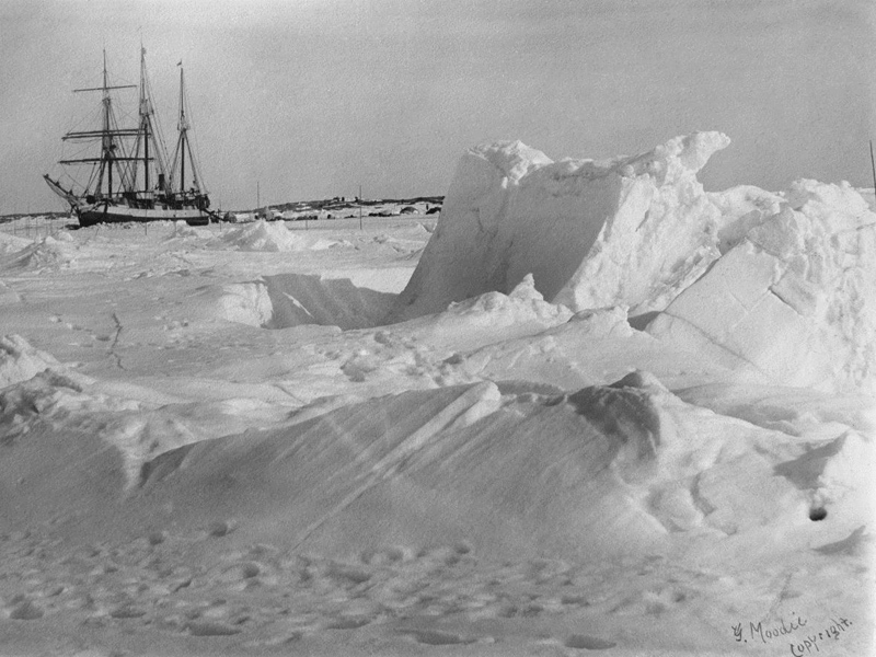 A very old photograph of a ship caught in arctic sea ice