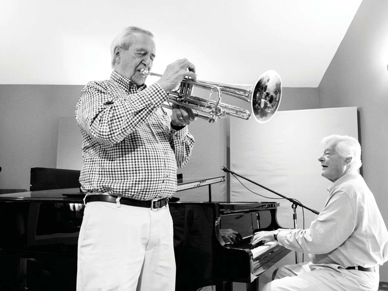 A black and white photo of Al Muirhead on trumpet and Tommy Banks on piano