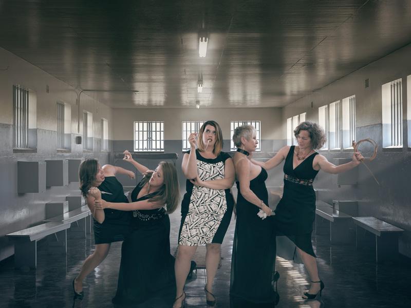 Five opera singers in a prison-like setting