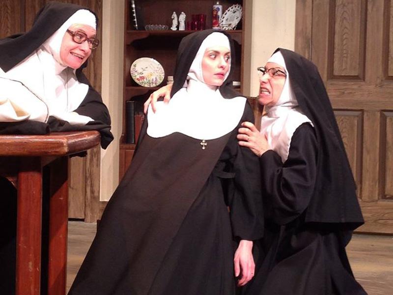 Three nuns on stage