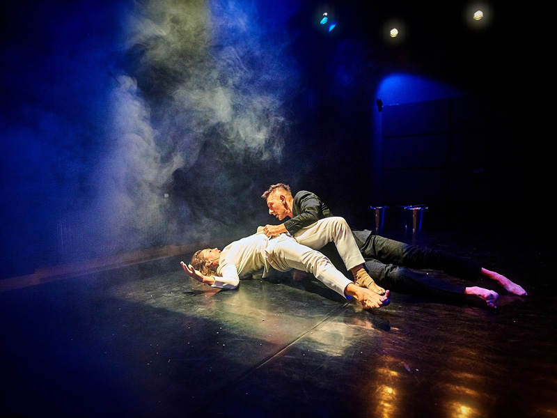 Two contemporary dancers on stage