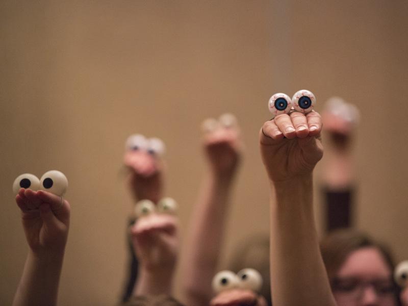 Photo of hands wearing eyeballs