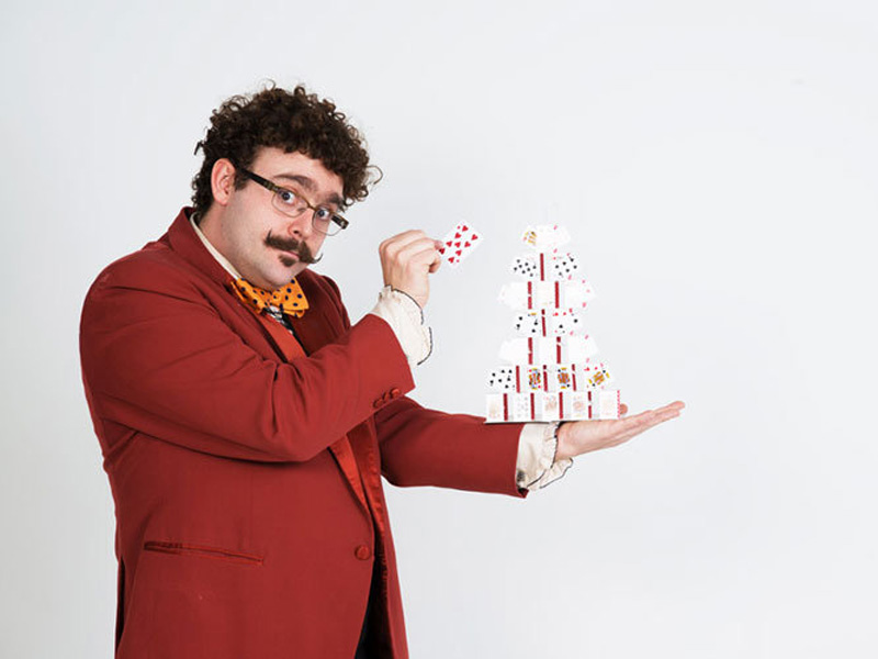 Magician James Jordan holds a house of cards