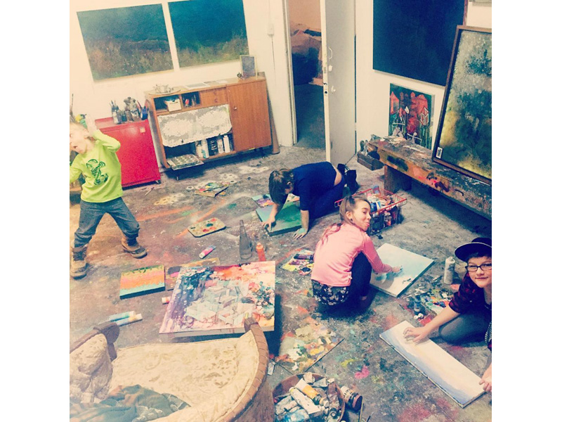 A photo of children creating in a studio