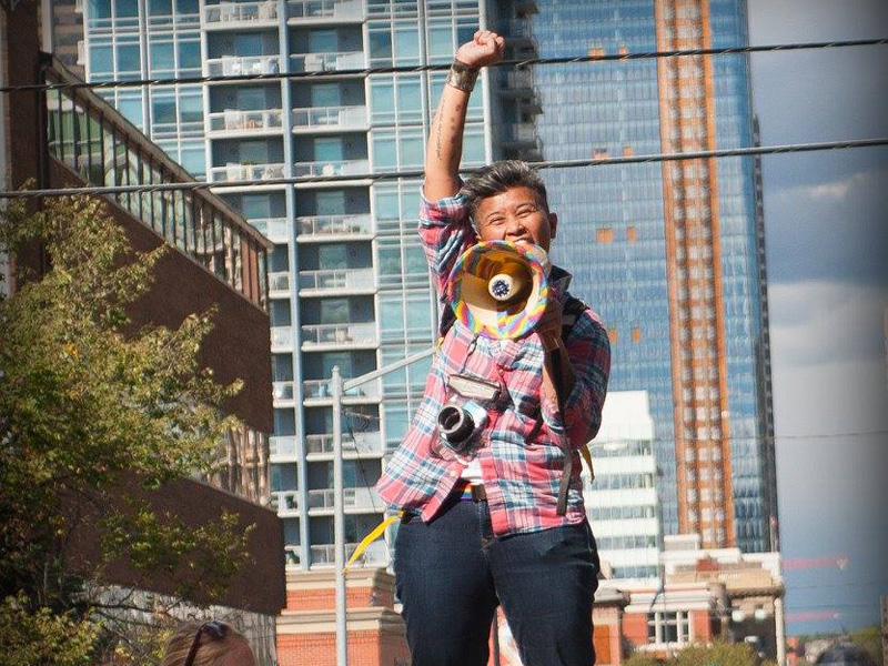 Tet Millare speaks at the 2016 Calgary Dyke and Trans March
