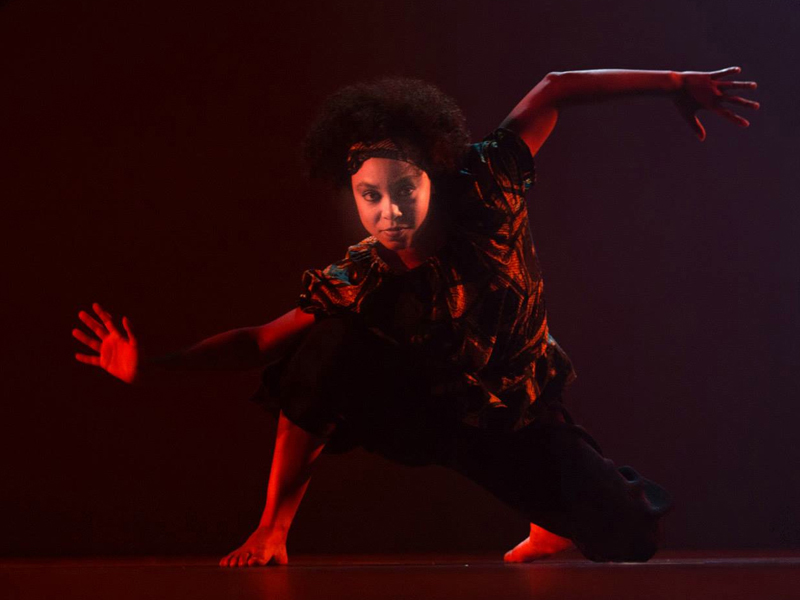 Photo of a dancer in red light