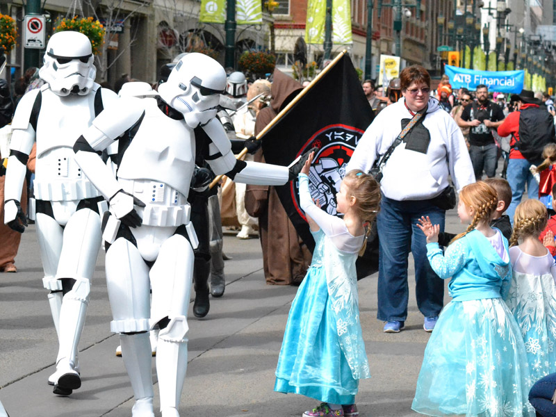 Three Elsas high five a group of storm troopers