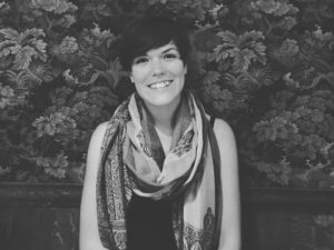 A black and white photo of Taylor Poitras