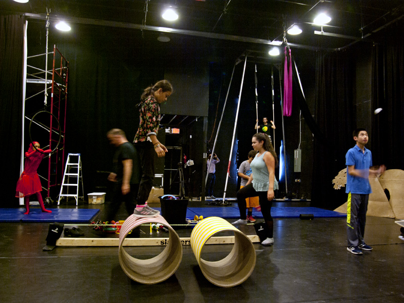 Participants of a special Social Circus Camp rehearse at the West Village Theatre
