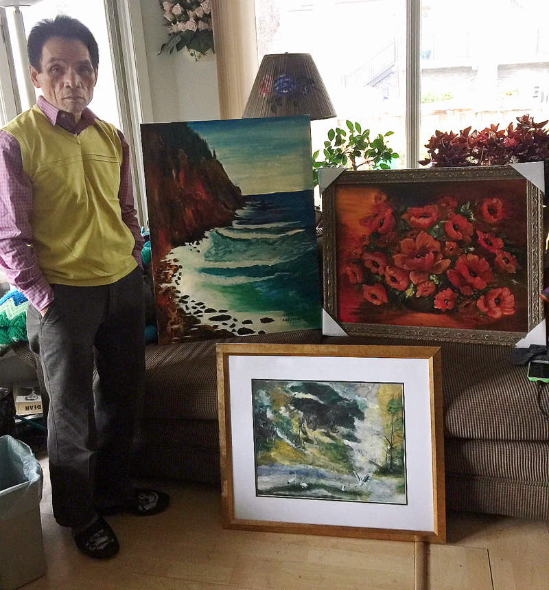 Kien Phi Ly shows off his paintings