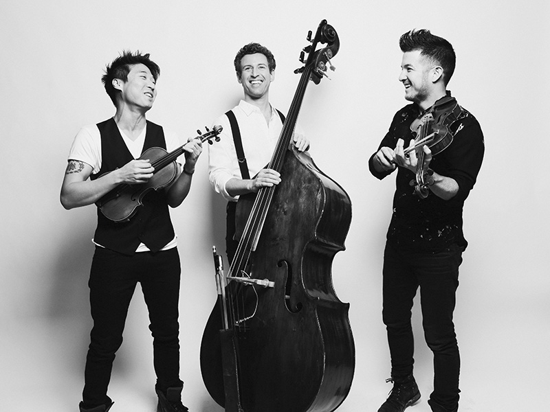 Photo of three musicians and their instruments