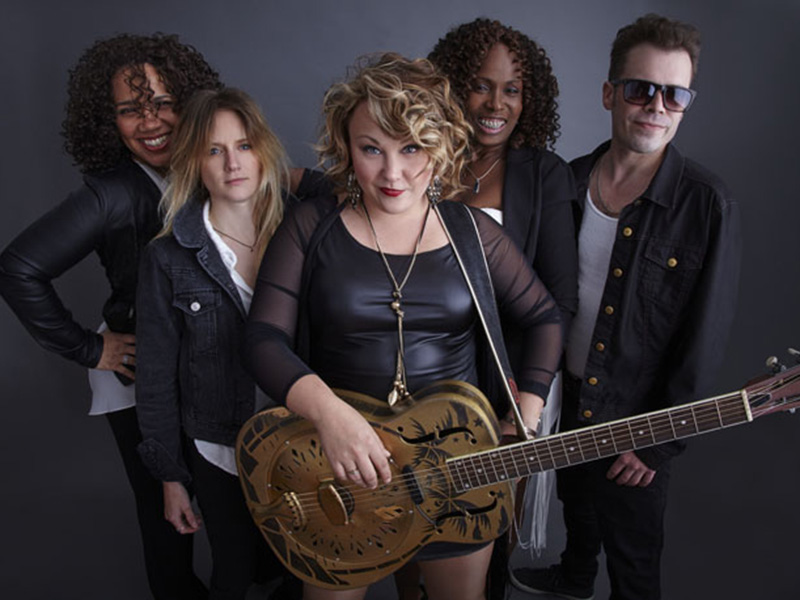 Samantha Martin (holding an acoustic resonator guitar) is Delta Sugar's driving force.