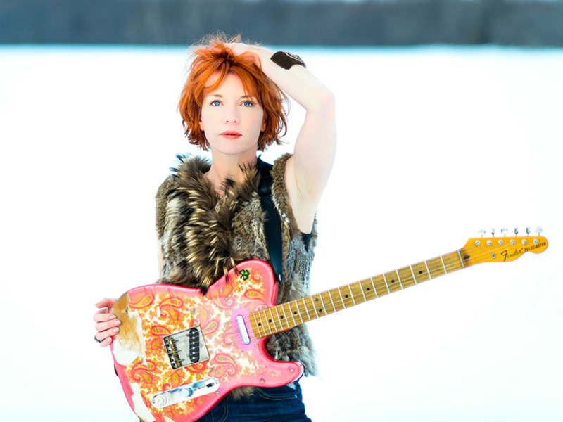 Photo of Sue Foley and her guitar