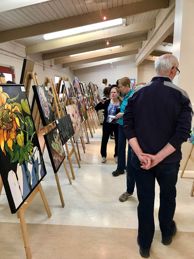 Show goers explore From the Easel's annual show and sale