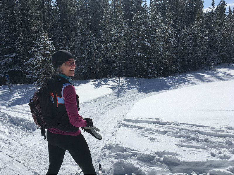 Barb Howard out cross-country skiing on a sunny day