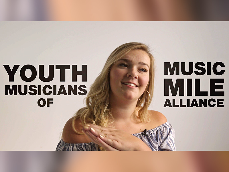 Video still with Kate Stevens and the word Youth Musicans of Music Mile Alliance