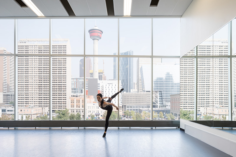 Catherine Hayward dances in theDJD Dance Centre with a view of the Calgary Tower