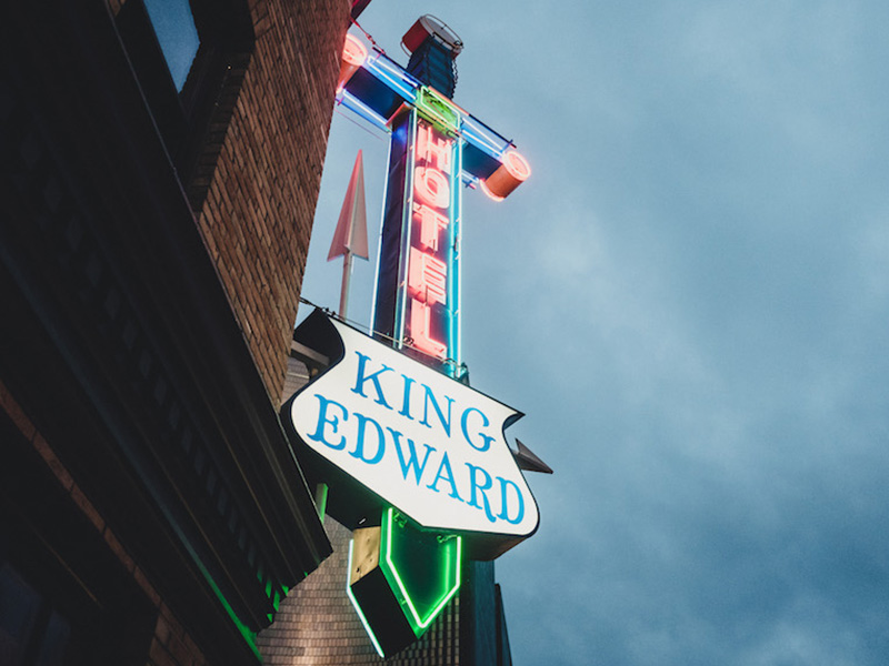 Photo of the historic neon sign that says King Edward Hotel