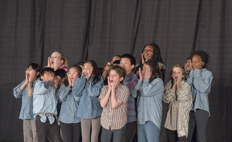 St. Jerome School students performing with Trickster Theatre artist Devon Dubny