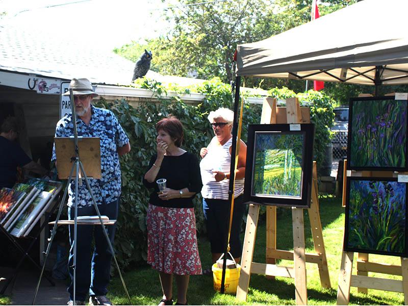 Photo of people enjoying Art in the Garden