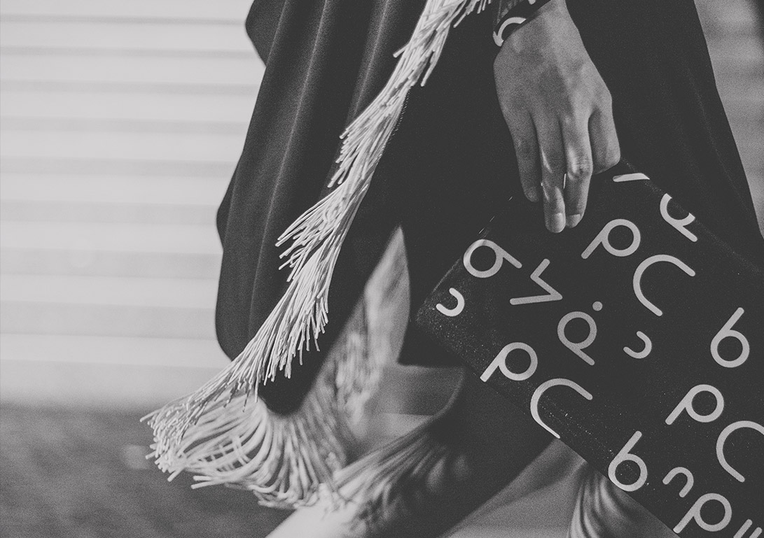 A black and white image of a bag with tradtional lettering