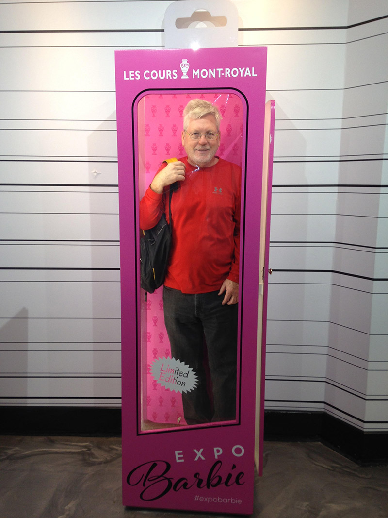 A photo of Richard White standing in a full sized Barbie box