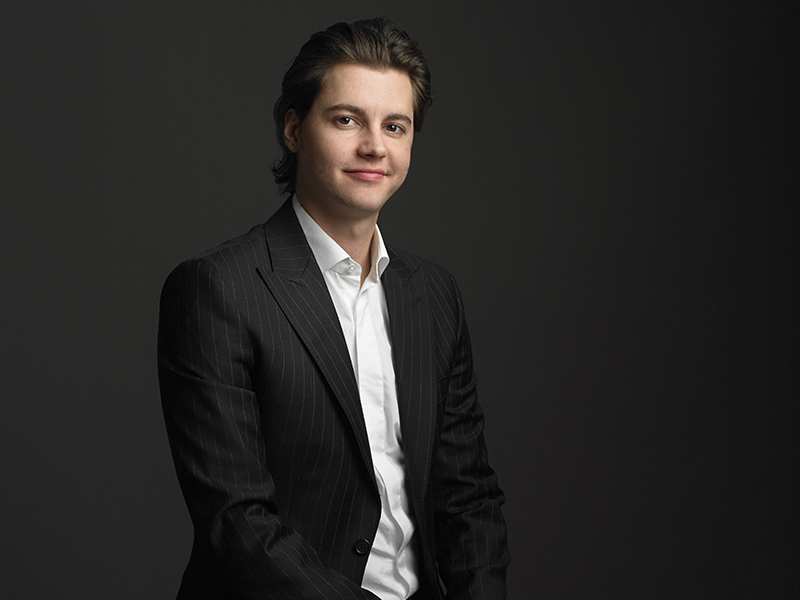 A formal photo of Calgary Philharmonic Orchestra's Associate Conductor Karl Hirzer