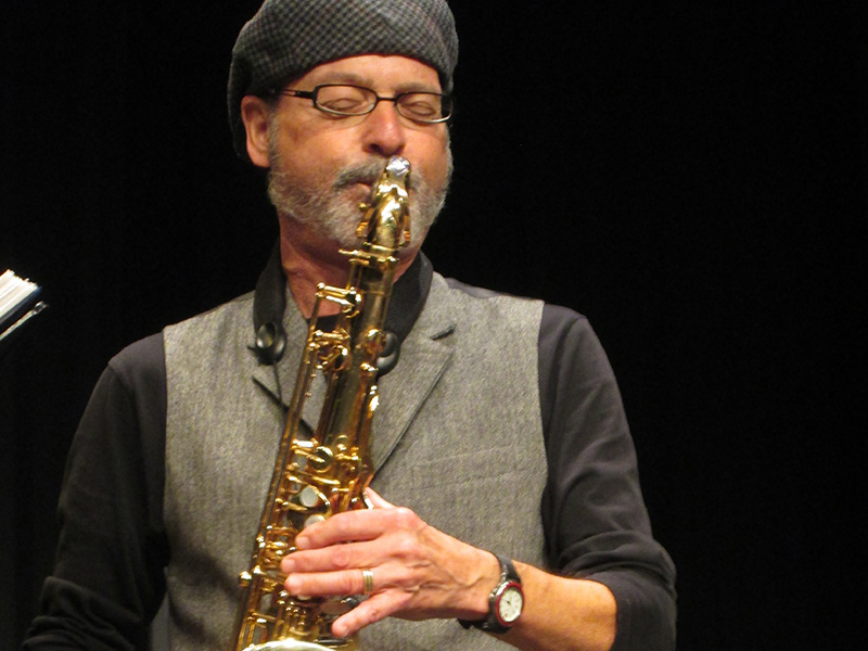 Rick Climans plays the saxophone