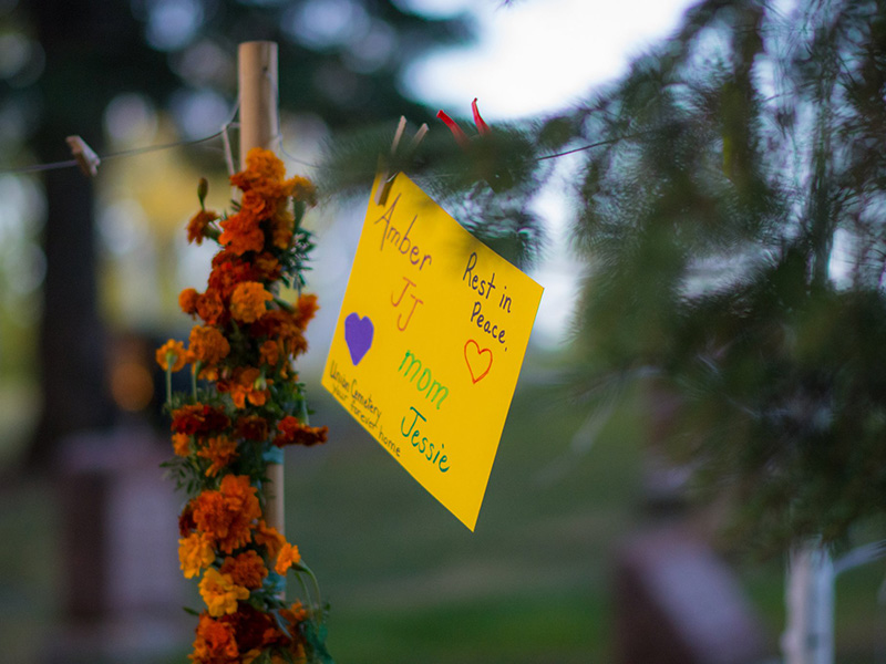 A photo of flowers and notes at the Equinox Vigil