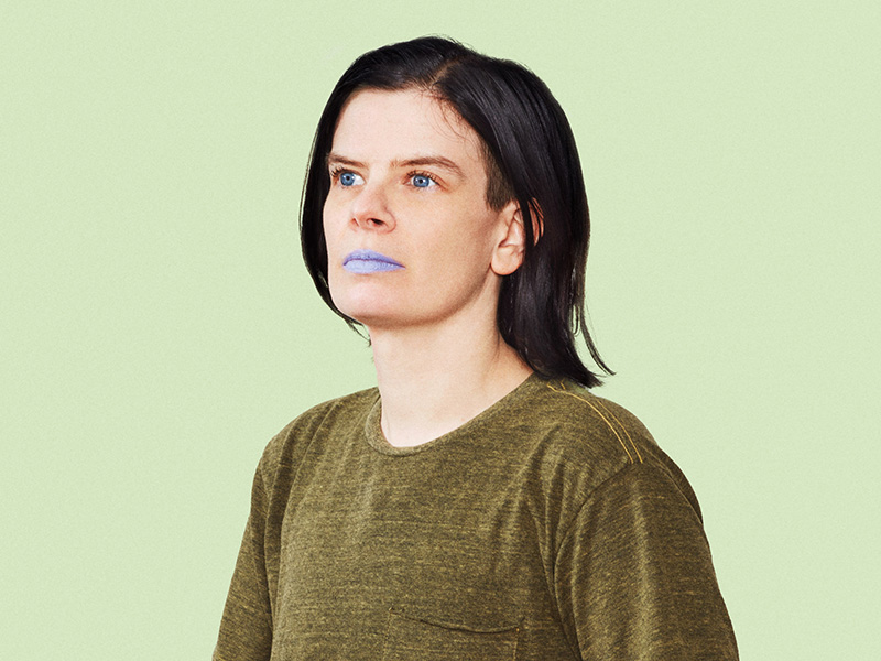 Promo photo of Rae Spoon wearing pale purple lipstick