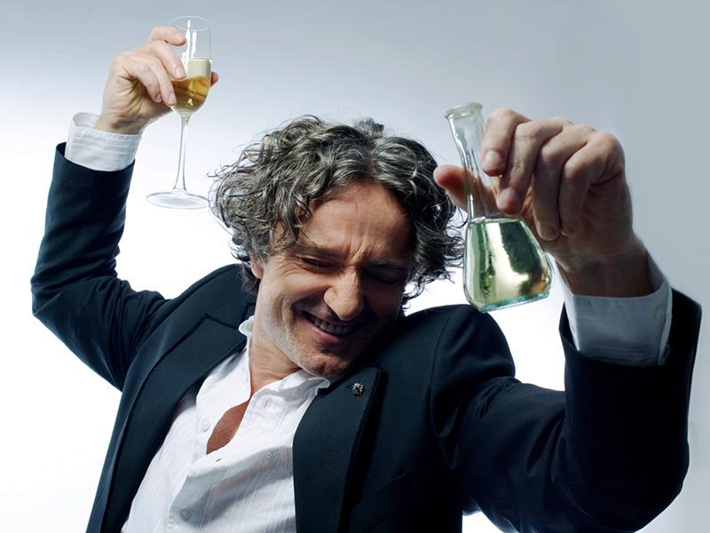 A promo photo of Goran Bregović toasting with wine glasses