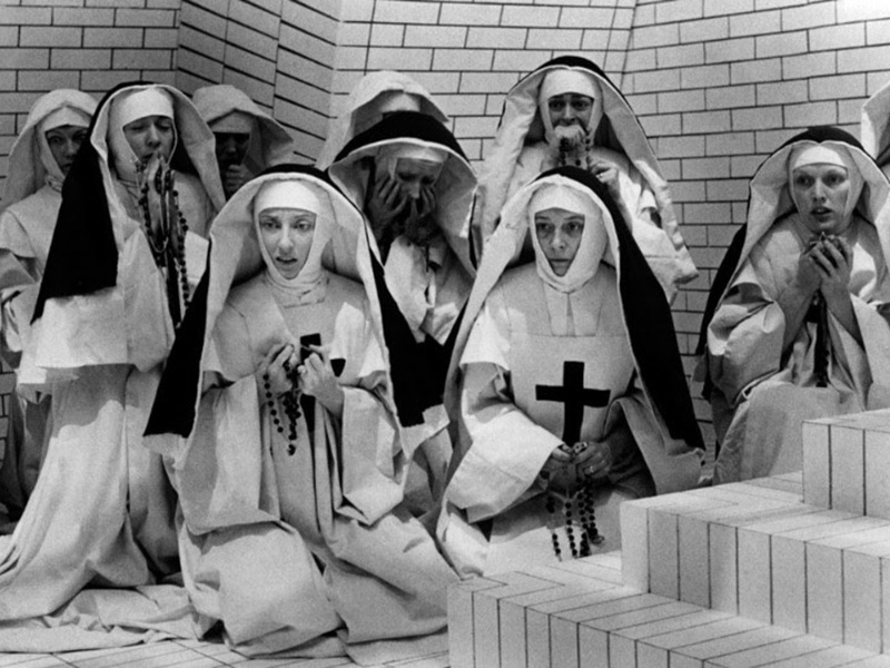 A black and white still of a group of nuns
