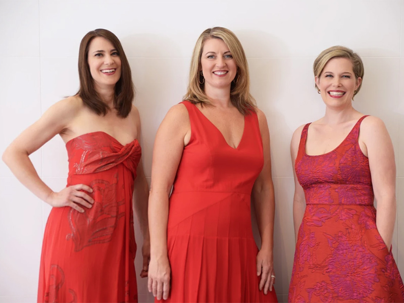 Three women in red dresses