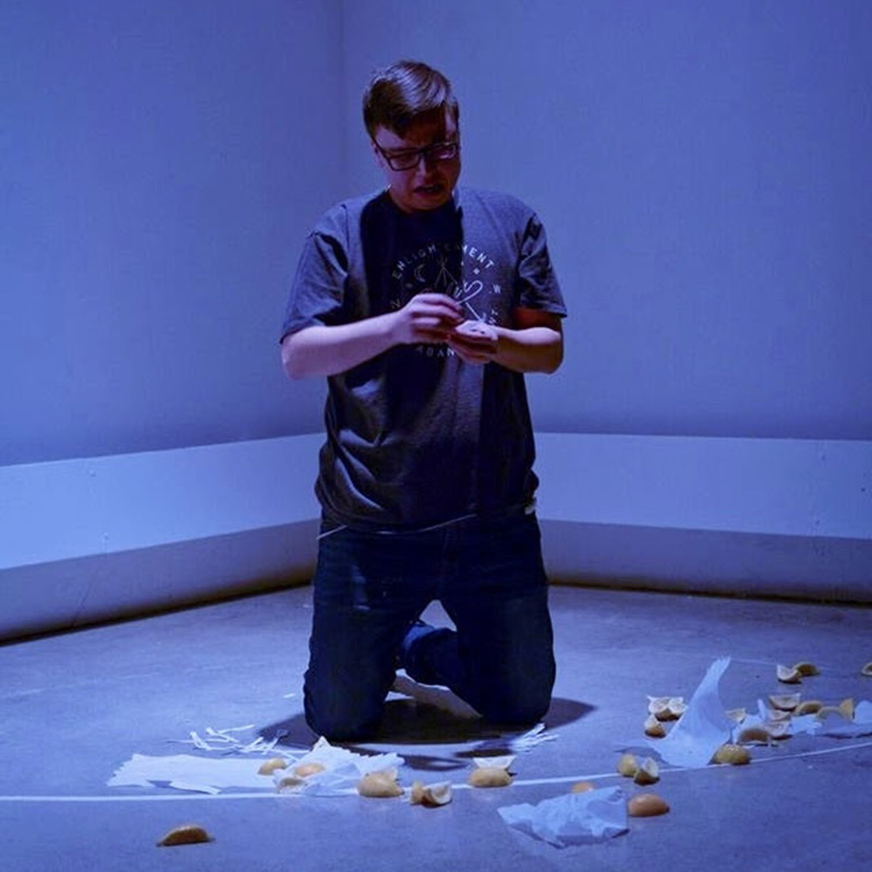A blue room with Dan Cardinal McCartney surrounded by cut lemons