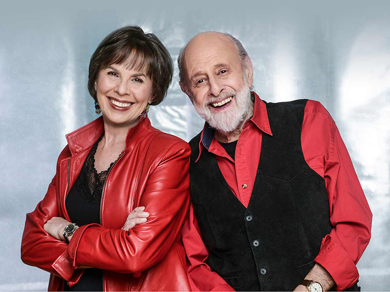 A photo of Sharon Hampson and Bram Morrison celebrating the 40th anniversary of their first album
