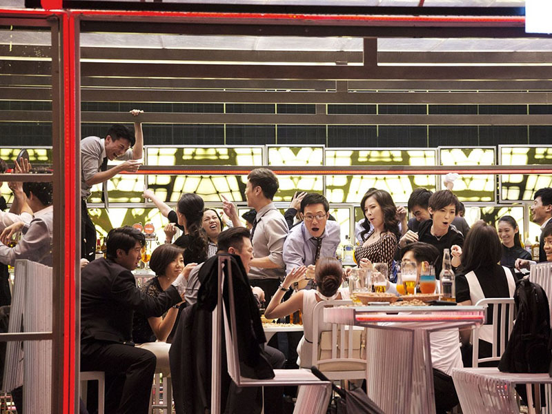 A still from Johnnie To's Office of a party in a restaurant
