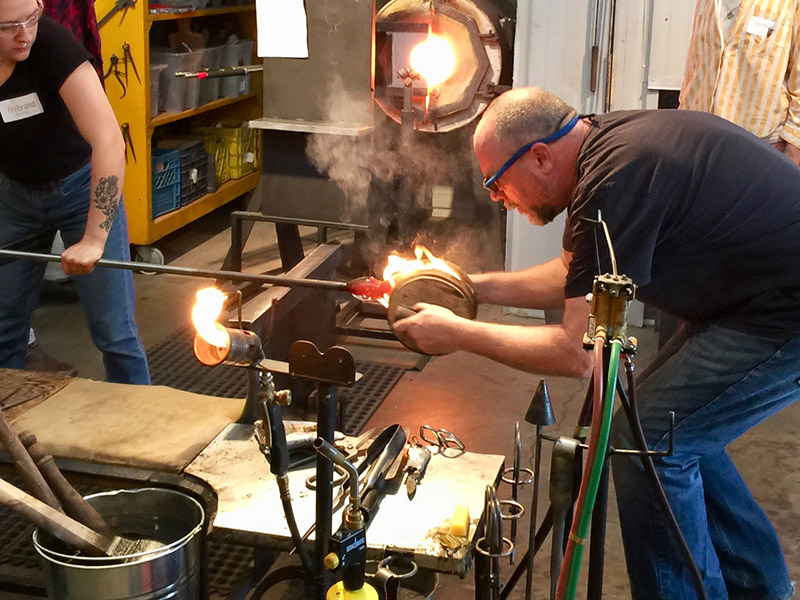 A glass blowing demonstration at Firebrand Glass Studio