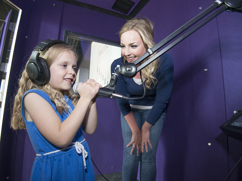 A woman and girl in Studio Bell's vocal booth
