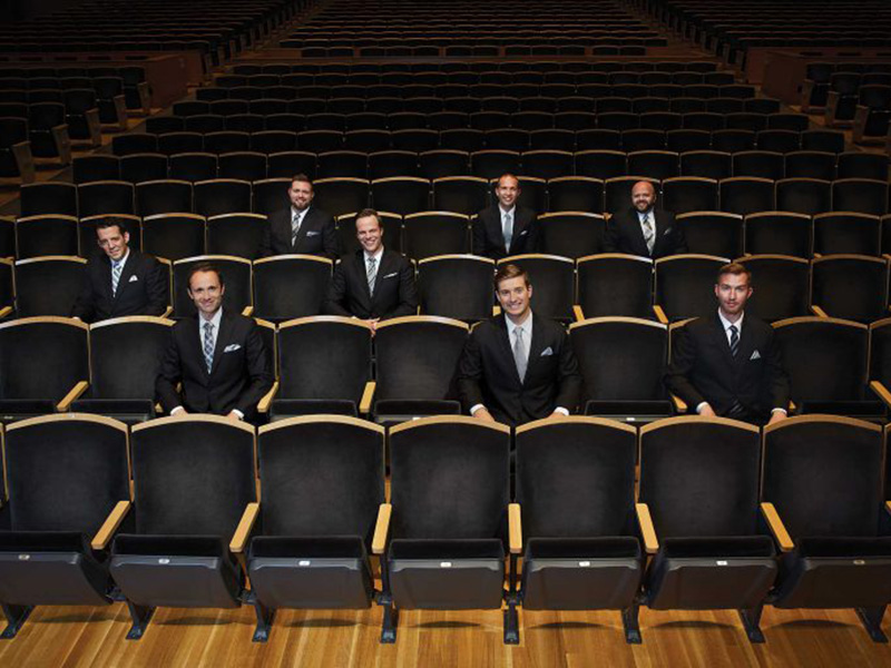 A promo photo of the Cantus Vocal Ensemble sitting amongst empty theatre seats