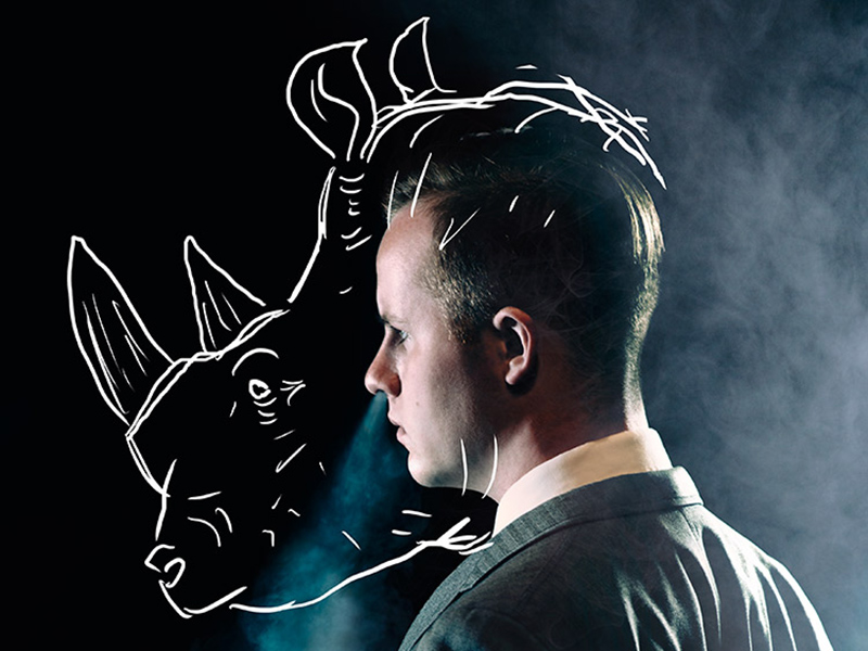A promo image from Rhinoceros with a man's profile with a rhinoceros head sketched over it