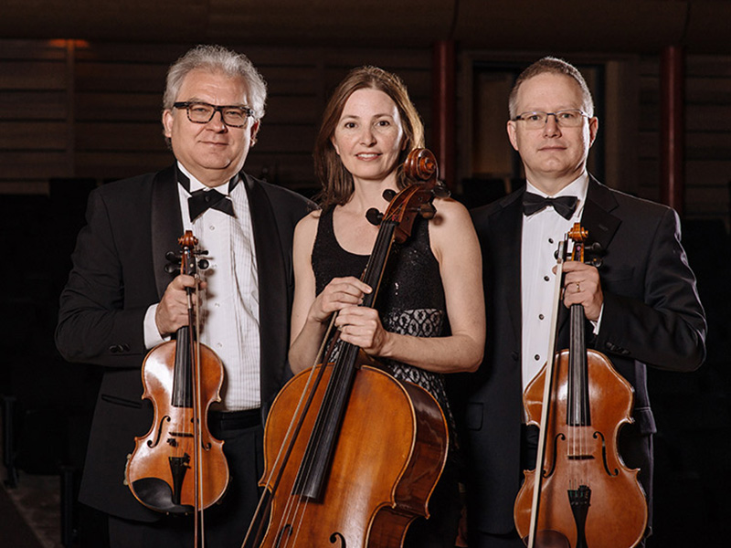 A photo of three members of the UCalgary String Quartet
