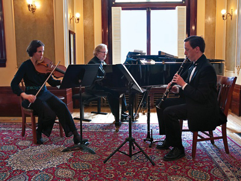 A trio of classical musicians performing